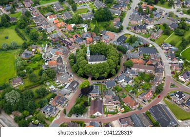 9 July 2016, Spijk, Holland. Aerial view of beautiful dutch village Spijk with Andreaskerk in the province of Groningen, Holland. The town is built on a terp or mound and has a church in the center.