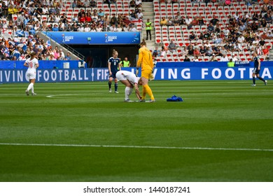 9 June 2019 Nice, France - England's Karen Bardsley left gets her boot laces tied by her teammate during the England v Scotland, FIFA Women's World Cup game