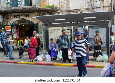 9 May 2018 Commuters waiting for a bus in a local bus shelter near the Mahane Yehuda street market in Jerusalem Israel