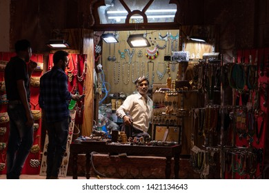 9 May 2019; Red Fort, New Delhi, India; tourists buying souvenirs from the local Indian trader in souvenir shovel in the passage tunnel in the fort.