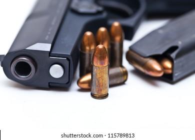 9 mm Black handgun isolated on a white background.