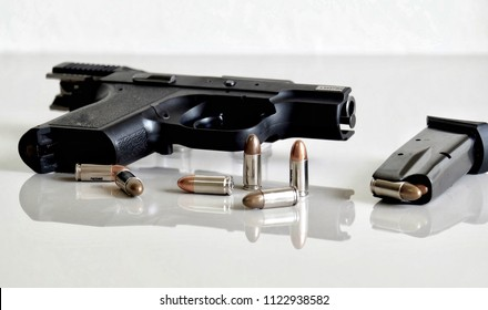 9 mm Hand gun or pistol with ammunition or bullets and magazine isolated on white background.