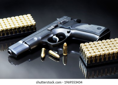 9 mm pistol and luger ammunitions on a black mirror base.