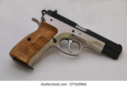 9 mm pistol with wooden handle.