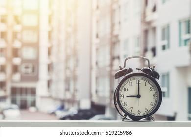 9 o'clock retro clock with The Clock condominium background.