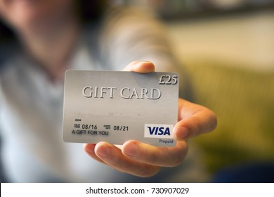 9 October 2017 - Royston UK - Woman holding a £25 gift card (Illustrative editorial)
