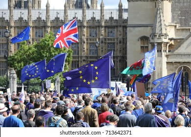 9 September, 2017. Westminster, London.  EU and Uk flags as a crowd gather for an anti-Brexit rally at the Houses of Parliament in the week when the EU withdrawal bill was introduced to parliament.