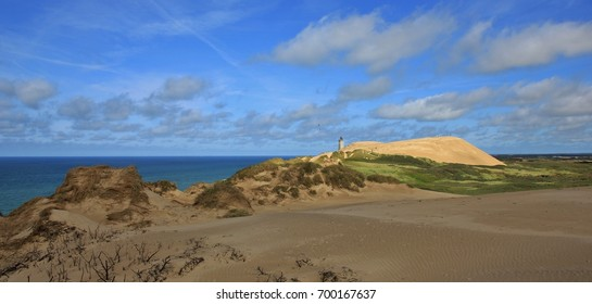 90 meter high sand dune and old lighthouse. Rubjerg Knude, Denmark.