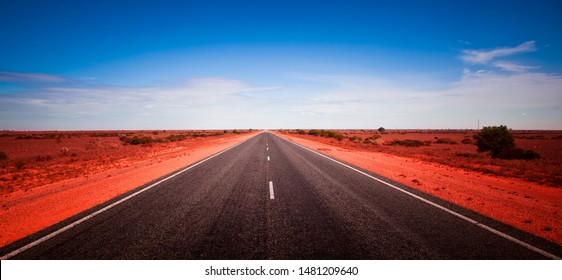 90 Mile Straight. Australia's longest straight road. Open road crossing the Nullarbor Plain in Western Australia. Long road stretching into the distance. Adventure Travel.