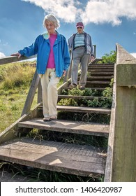 90 year old man takes his wife,who has severe sight loss to Danebury Ring in Wiltshire to get her out in nature and away from the confines of her house. She has acute macular degeneration.