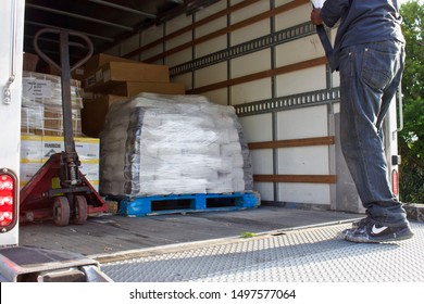 9/06/2019 Miami,Florida-Delivery truck filled with  stretch wrapped pallets of merchandise for  secure delivery to customers. Driver with bill of lading in hand.