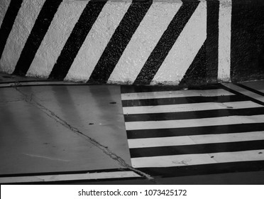 90s trend: Grunge and punk scenarios. Parking detail with stripes and wall in first plan. Chaos, urban and dystopia concepts.