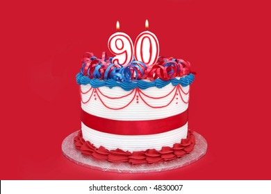 90th cake with numeral candles, on vibrant red background.