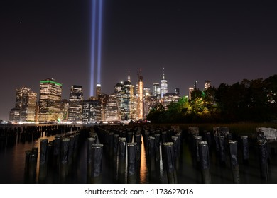 9/11 Memorial Lights and Downtown New York City Skyline With Piers in the Foreground