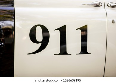 911 text on side of a police car. 911 Emergency response police car.