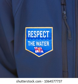 9/11/2016. Plymouth UK: A close up of an RNLI Respect The Water patch on a blue fleece jacket.