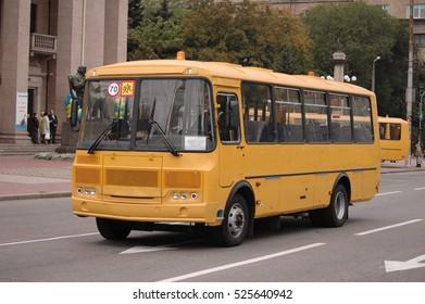 9/27/2016 Zaporizhia, Ukraine: School bus goes on road on the Avenue