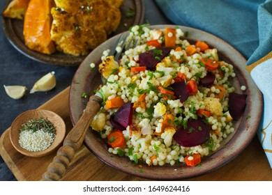 9.Light healthy dietary vegan dish: couscous with fresh and baked vegetables