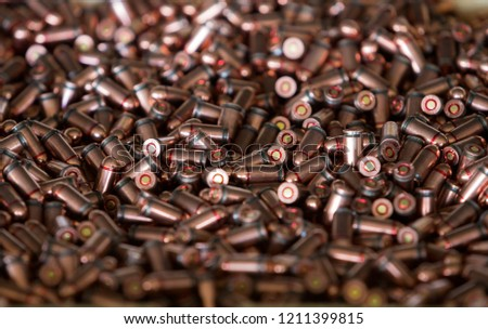 9mm ammo bullets. Military war background. Army supplies. Texture wallpaper.