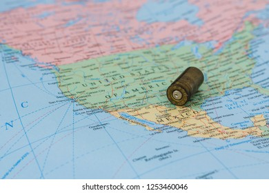 9mm bullet casing on a map of the United States and Mexico
