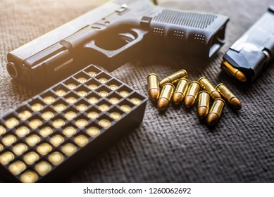 a lot of 9mm bullet and gun with a magazine