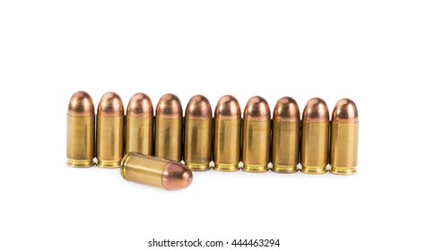 9mm bullet isolated on white background .