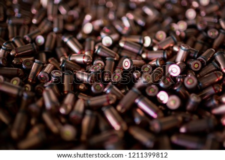 9mm bullets. Military war background. Army supplies. Texture wallpaper.