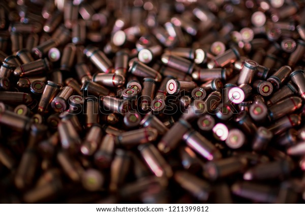 9mm bullets. Military war background. Army supplies. Texture wallpaper. Ammo