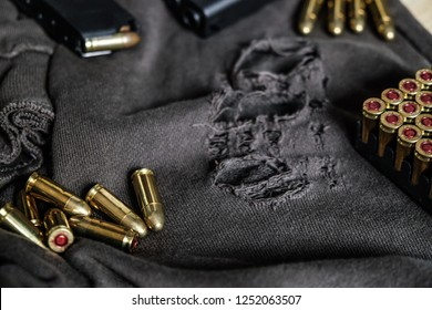 9mm full metal jacket bullet on dark cloth, Weapon concept