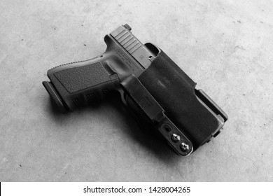 9mm glock 19 handgun in a holster setup for daily concealed carry