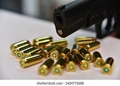 9mm gun and bullet on wooden background. Pistol isolated on wooden background. Hand gun and bullets on wooden background