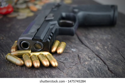 9mm gun and bullets on wooden.Concept of crime and violence.