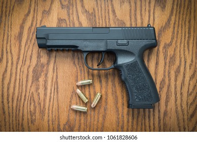 9mm Handgun on Wood Surface at Home