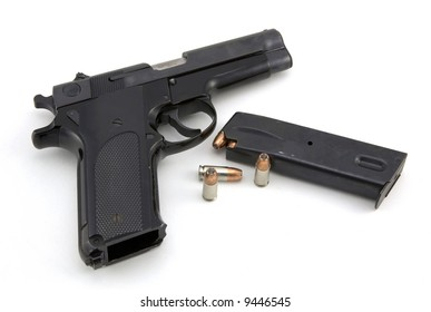 9mm pistol and ammo isolated on white background