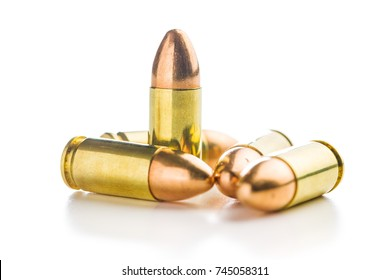 9mm pistol bullet isolated on white background.