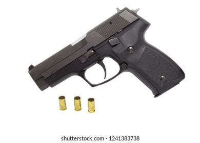 9mm pistol with empty casings isolated on white