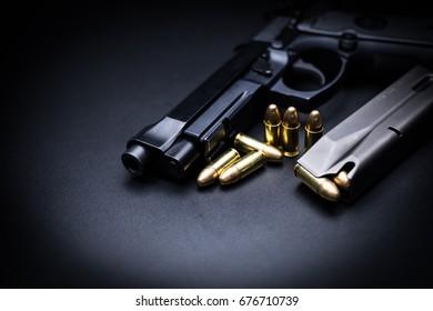 9mm pistol gun on black background