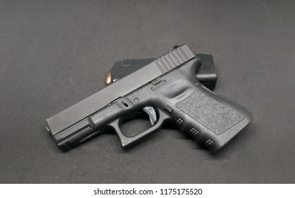 9mm Pistol and loaded magazine on black background