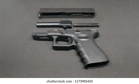 9mm Pistol is separated to pieces on black background.