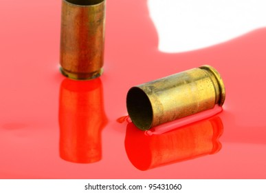 9mm spent shells and blood studio shot