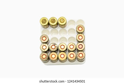 9mm surplus ammo with empty casings in the box isolated on white