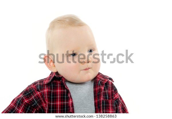 A 9-month-old boy in a plaid shirt on white background