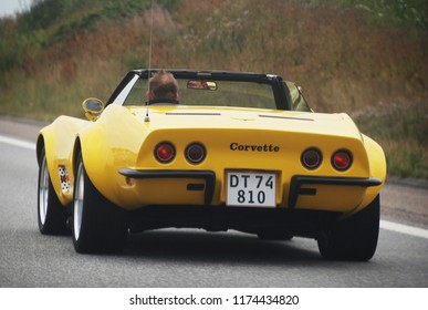 9th of August 2014 - Scene from a Danish highway with close up of a yellow Corvette, Aalborg, Denmark