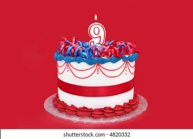 9th cake, with numeral candle, on vibrant red background.