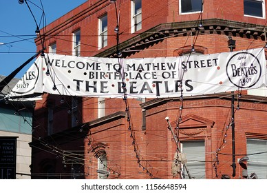 9th of July 2010 - Scene from English city with banner welcoming tourists to Mathew Street, Birthplace of the Beatles, Liverpool, England