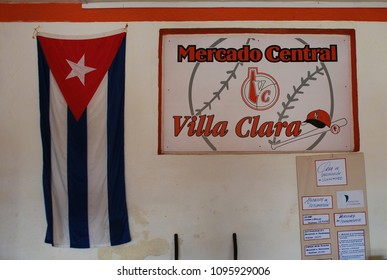9th of November 2013 - Scene from a Cuban city with details from a wall qwith a cuban flag and a sign saying: Mercado Central (Central Market), Santa Clara, Cuba