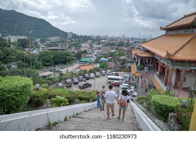 9th September 2018  Tourists walking down from the higher ground of the old sacred buddhist Kek Lok Si temple at Georgetown,  Penang,  Malaysia.