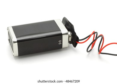 9v battery attached to connector on white background