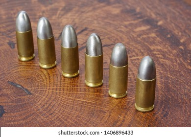 9x19mm Parabellum a firearms cartridges that was designed by Georg Luger and introduced in 1902 for the German weaponson wooden background