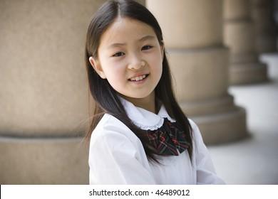 9-year old asian school girl in school uniform